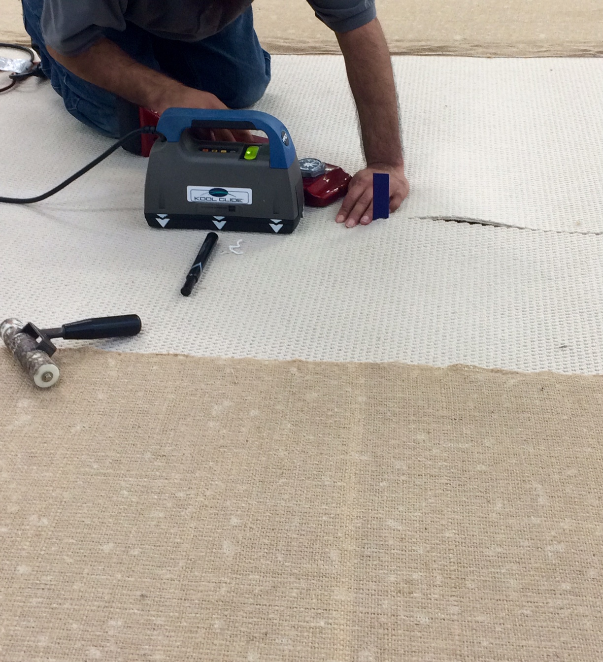Seaming two cuts to make a rug wider that the original width.
